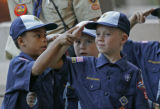 0130 Bear Cub Scouts Cameron Meche, 8, (from father) helps  fellow Cub Josh Hall, 8, both from...