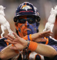 WEB CAPTION:   A Broncos fan shows disappointment as a penalty is called against Denver in the...