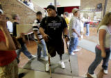 Classes let out for lunch as Nikko Landeros (cq),18, makes his way through the halls of Berthoud...