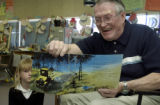 (ARVADA, Colo., April 27, 2004) Bill Johnson, 75, reads and shows a book with Rachel Buesser,8,...