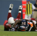 Denver Broncos running back Selvin Young stetches for extra yards on third down against the...