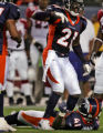 Denver Bronco's safety Hamza Abdullah, top, calls for medical staff to give attention to Karl...