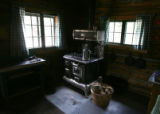 An old Helpmate Universal wood burning stove in one of the cabins at 30-Mile Resort, Tuesday...