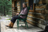 Charlotte Trego (cq) sits in a chair in front of one of her old cabins at her 30-Mile Resort,...