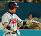 PPS101 - Atlanta Braves' Chipper Jones is congratulated after hitting a three-run home run off...