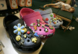 0116 Crocs with Jibbitz are displayed at the Boulder Running Company while Tanner Baird, CQ, 6,...