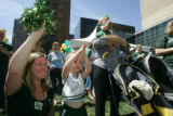 Colorado State alumnus Nicole Long, class of 1996, cheers with her daughter Ashlyn Long, 3, a pep...