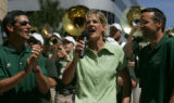 Colorado State athletic director Paul Kowalczyk, left head womwn's basketball coach Jen Warden,...