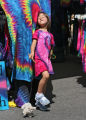 Lily Valenta, 6, plays with a toy dog at her mother tie-die booth,   Friday afternoon, August 31,...