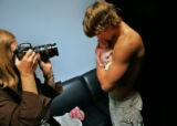 Local Denver professional photographer Debi Tipton photographs young father Matt Icopini, 16,  of...