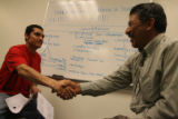 (from left) Luis Vasquez (cq), originally from Gualajara, Mexico, shakes the hand of Adolfo...