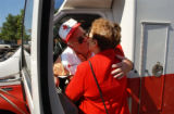 (DENVER, CO., SEPTEMBER 3, 2004) (Lt. to Rt.) Red Cross volunteer Hal Smith received a farewell...