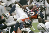 0447 Denver Broncos running back Travis Henry gains two yards on first down agains the Oakland...