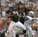 0249 Denver Broncos defensive tackle Marcus Thomas grabs a deflected pass against the Oakland...