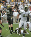 University of Colorado kicker Kevin Eberhart, leaps in the air  after his game winning field goal...