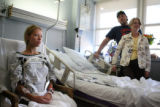 (at left) Michelle Zoril (cq) talks to the media at her room at St. Anthony Central Hospital, as...