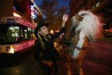 Carriage driver, Vania Rogers (cq) gives Stiger a 5 yr old Belgian stallion a scratch along his...