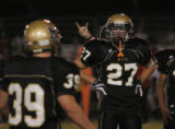 Monach HS's #27 Tyler Hamlin listens to the coach's instruction during Monach HS football game...