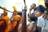 [Denver, CO - Shot on: 9/19/04] Tibetan monks blow through ceremonial horns while best friends...