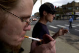 [{DENVER, {CO} - September 19, 2004]  Brian O'Reilly, left, and Daniel Sorger light up cigaretes...