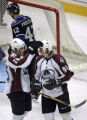 [ES108] Colorado Avalanche center Paul Stastny, left, pats teammate  Ryan Smyth in the head after...