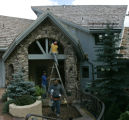 0067 Workers paint a home belonging to millionaire aviator Steve Fossett at 60 Elk Track Court in...