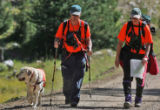 CODER101 - L to R: Rosie (cq) a yellow lab search dog along with Allen Weaver (cq) and Robyn Bond...