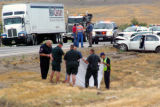 Officials sheild the Body of a Nevada Semi Truck Driver who was struck and killed after crossing...