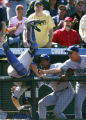 Dodgers catcher Russell Martin, left, is helped by coaches Mariano Duncan, center, and Dave Jauss,...