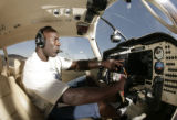 **SPECIAL TO THE ROCKY MOUNTAIN NEWS** Ex-NFL football player Terrell Davis inside the cockpit of...
