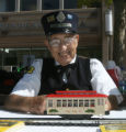 Erwin Chaim (cq) waits for volunteers at the Platte Valley Trolley booth, Thursday morning,...