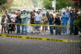 Zach Ornitz/Aspen Daily News Curious pedestrians gather at the edge of a police barrier on the...