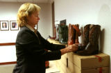 Barb Perkins (cq), U.S. Fish & Wildlife Service, organizes boots made from sea turtles,...