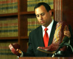 Troy Eid, U.S. Attorney for the District of Colorado, holds a boot made from sea turtles, Thursday...