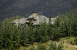 0091 The main house is surrounded by mature Aspen and pine trees at the Hala Ranch which is listed...