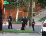 Denver Police investigate the 6000 block of West Yale Avenue early Monday morning July 16,2007....