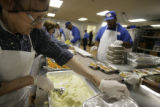 Patrick Long(cq), who is a new employee of Meals on Wheels, prepares meals for those in need at...