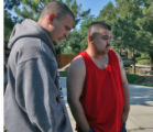Robert Ortiz (cq),17, and Bobby Rivera (cq), 30, stand in  the 6000 block of West Yale Avenue...
