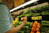 Doloris Dunn(cq), of Aurora, Colorado looks at a pepper on sale at King Soopers on Ileff Avenue in...
