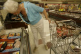 Doloris Dunn(cq), of Aurora, Colorado looks at seafood on sale at King Soopers on Ileff Avenue in...