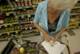 Doloris Dunn(cq), of Aurora, Colorado looks through her coupons while shopping at King Soopers on...