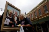 Paul Borrillo (cq), of Arvada, gets fed a piece of cake by Roselyn Kressin (cq), of Thornton while...