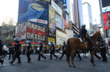 (08/28/2004 New York City)-New York police officers gather in Times Square as protestors converged...