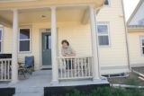 Susan Tatum on her porch of her duplex at 200 Cardinal Way, Unit D in the Blue Vista subdivision...