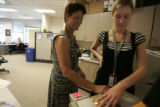 Linda Burton(cq), of Arvada, is fingerprinted by Shawna Freeborn(cq), an associate recruiter for...