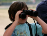 Malachi Fellure, 5, looks through a pair of binoculars at the Jayhawker Ponds (West 1st and Taft...
