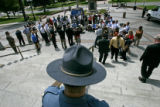 0619 A Colorado State trooper keeps a birds-eye view of a press conference led by Governor Bill...