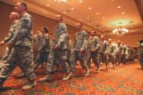 Members of the 169th Fires Brigade Colorado National Guard march into  a homecoming ceremony at...