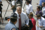 0180 Governor Bill Ritter is escorted by state toopers after addressing the media regarding the...