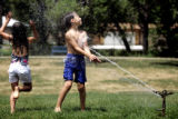 Marisa Bobian, 7,  left, and Antonio Ammann (cq) 10, find relief from the near 100 degree heat...